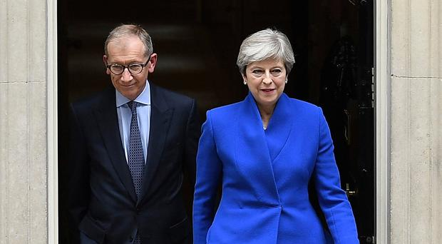 PM Theresa May leaves Downing Street with husband Philip to go to Buckingham Palace yesterday