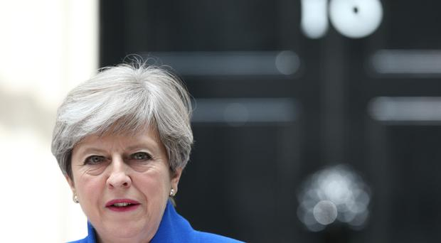 Britain's May seeks deal to cling to power