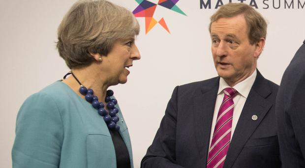 Enda Kenny has spoken with Theresa May.