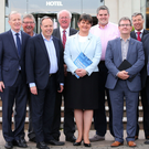 DUP leader Arlene Foster along with her newly elected 10 MPs at the Stormont Hotel in south Belfast last Friday