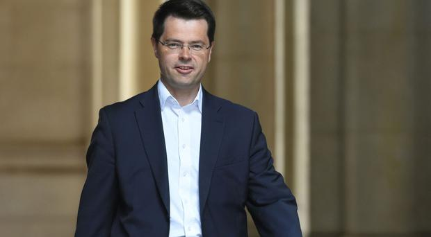 James Brokenshire said there was a need to differentiate between politics at Westminster and Stormont