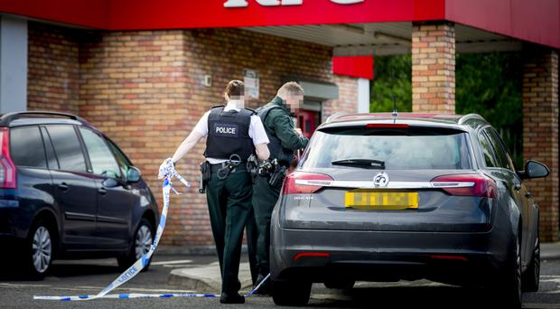 Police officers at the scene of a suspected overdose in the toilets of KFC, close to Yorkgate
