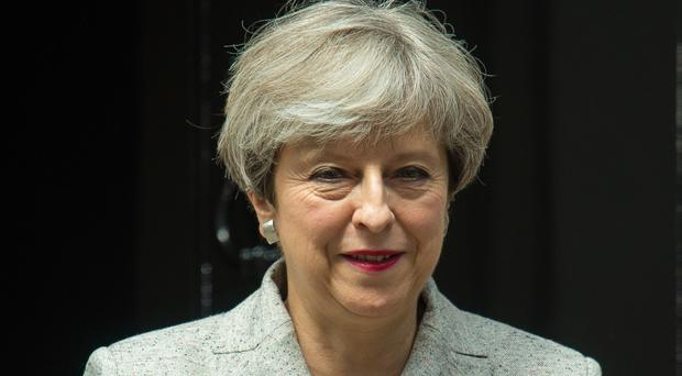 Prime Minister Theresa May leaves 10 Downing Street in London during talks with DUP leader Arlene Foster and DUP deputy leader Nigel Dodds