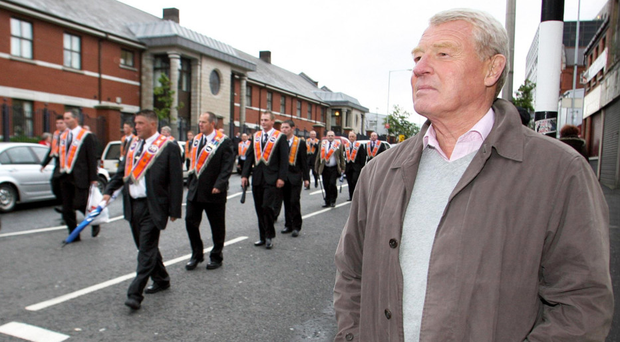 Lord Ashdown, in his role as chairperson of the strategic review parading body, observing a loyalist parade in north Belfast