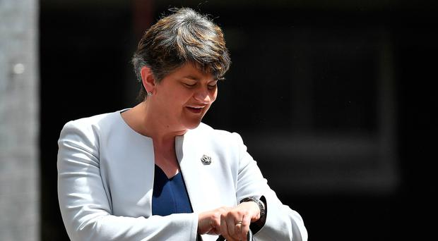 DUP leader Arlene Foster checks her watch as she arrives at 10 Downing Street yesterday