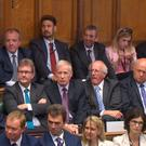 The DUP Members take their seats in the Commons