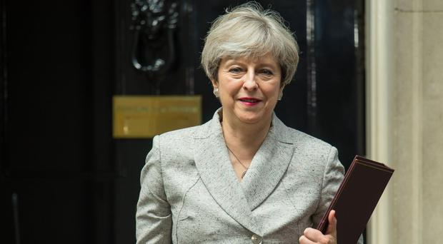 Talks between UK PM May's Conservatives and Northern Ireland's DUP restart