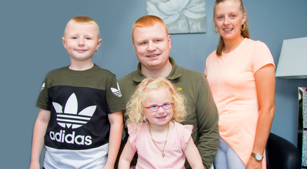 Andy Allen at home with his wife Natalie and children Chloe and Carter