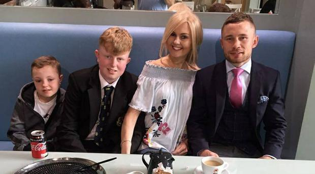 Aundrea Bannatyne and her sons James and Jack with former world boxing champion Carl Frampton