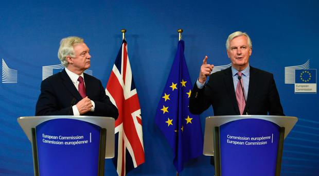 Brexit Minister David Davis (left) and Michel Barnier, European Commission member in charge of Brexit negotiations with Britain, address a joint press conference at the EC in Brussels