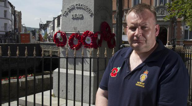Ricky McGaffin, Poppy Appeal officer for the Newry branch, at the damaged cenotaph