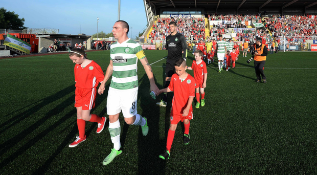 Celtic captain Scott Brown leads his players out before a Champions League qualifier between Cliftonville and Celtic at Solitude in Belfast in July 2013