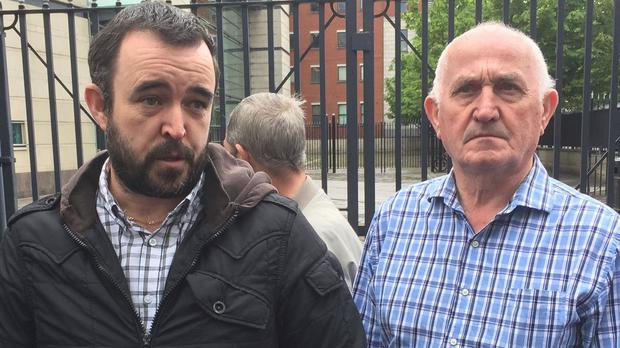 Eamon Fox's son Ciaran (left) and Gary Convie's father Joe outside Belfast Crown Court