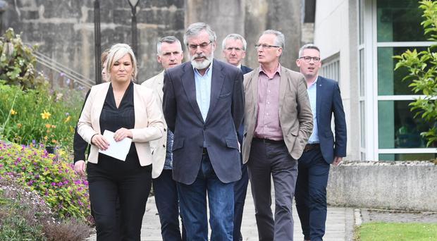 Gerry Adams, Michelle O'Neill and a Sinn Fein delegation at Stormont yesterday