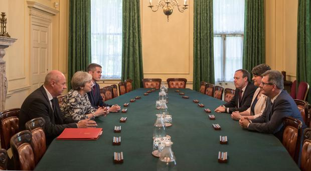 Prime Minister Theresa May (left), flanked by First Secretary of State Damian Green and Parliamentary Secretary to the Treasury and Chief Whip Gavin Williamson, holding talks inside 10 Downing Street with (right) DUP leader Arlene Foster, the party's deputy leader Nigel Dodds and MP Jeffrey Donaldson
