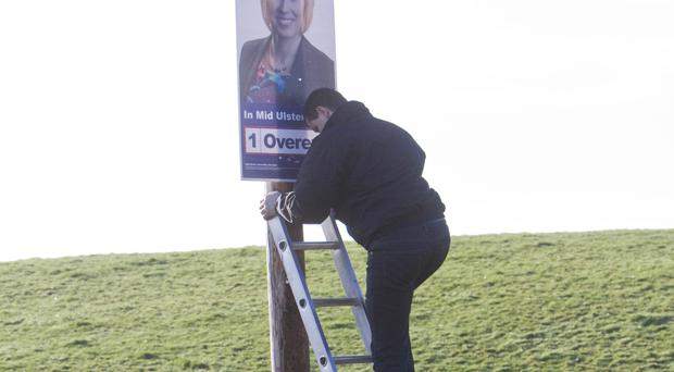 An poster being put up before the election