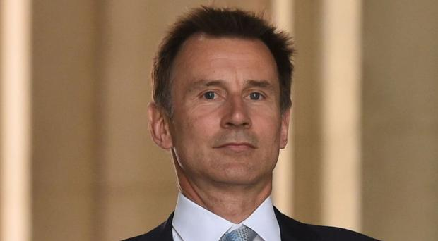 Jeremy Hunt has been urged to scrap charges for women from Northern Ireland who receive abortions in other parts of the UK