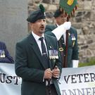 Parade organiser and former soldier Anto Wickham (centre) addresses a Justice For Veterans UK event in Antrim town last month