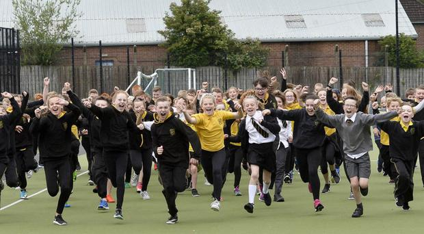 Pupils from King's Park Primary School in Lurgan celebrate their latest award