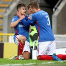 Linfield celebrate the winning goal in last night's match which takes them a step closer to meeting Celtic