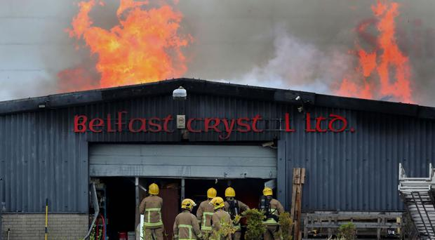 Crews tackle a factory fire at Belfast Crystal on Blackstaff Road in Kennedy Way industrial estate in West Belfast