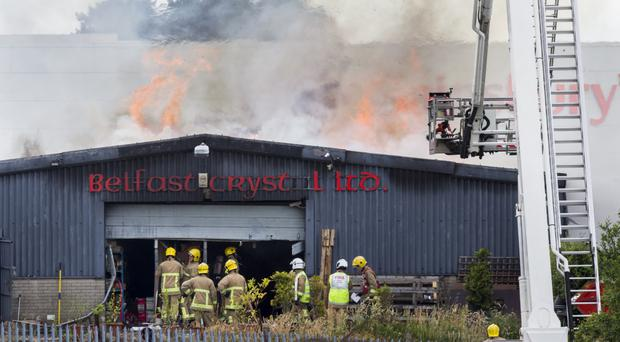 Firefighters tackle the blaze at the factory owned by Tony Abbate