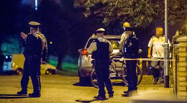 Police at the scene of the shooting in Norglen Parade in west Belfast