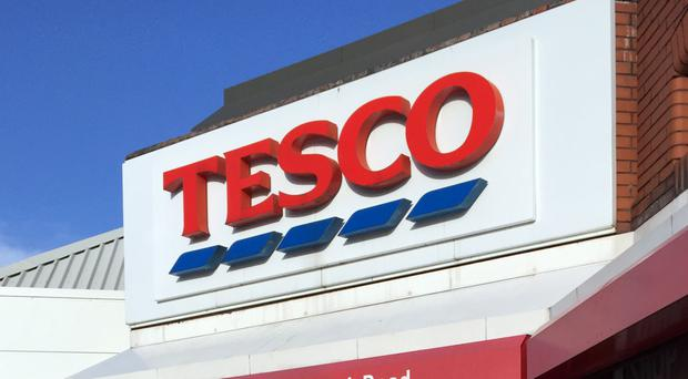 Cash-and-carry chain Booker shrugged off competition concerns surrounding its takeover by Tesco to reveal a warm weather-fuelled surge in sales