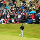 Crowds watch Rory McIlroy on the third green