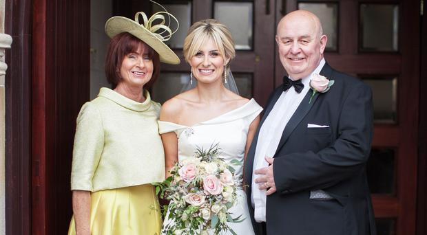 Ivan McCombe with wife Joanne and daughter Jade