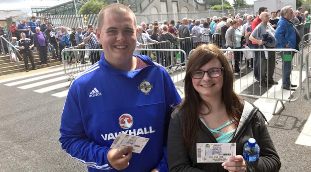 Linfield fans Aaron Champion and Amber Bush were among the hundreds who queued outside Windsor Park to get tickets for the Celtic clash