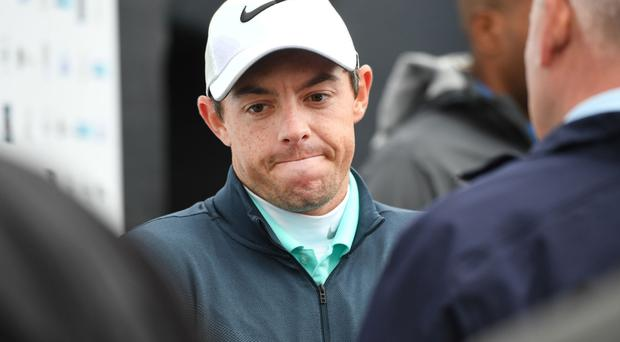 A dejected Rory McIlroy yesterday after he failed to make the cut on the second day at Irish Open at Portstewart Golf Club