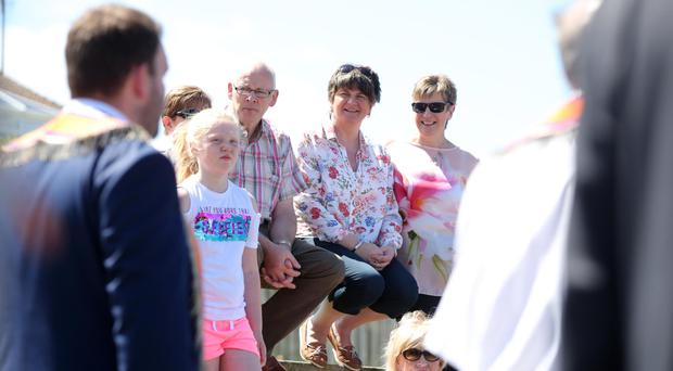 Spectators including DUP leader Arlene Foster enjoy the sunshine at the annual pre-Twelfth of July parade held in Rossnowlagh in Co Donegal