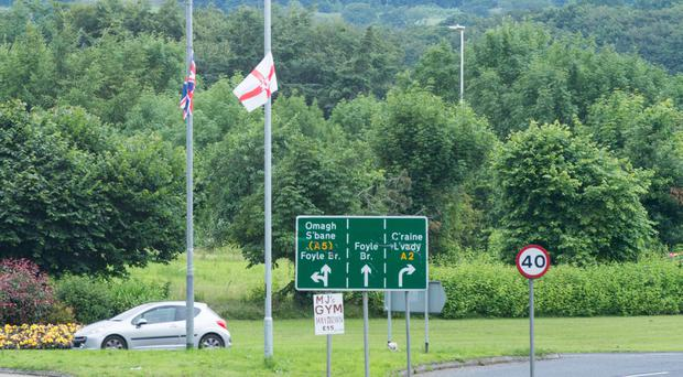 The flags at the Caw roundabout in Derry