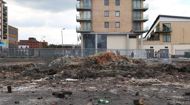 Smouldering remains of the Sandy Row bonfire just metres from apartments yesterday