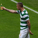 Leigh Griffiths shows referee the bottle that was hurled at him.