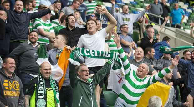 Uefa charge Celtic for illicit banners at Linfield game