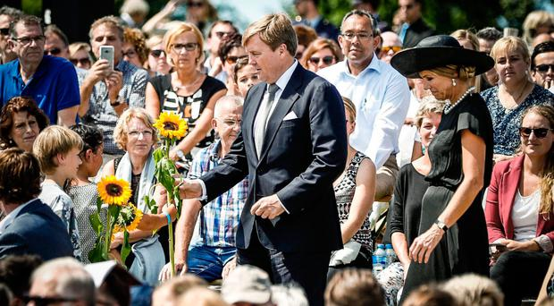 Dutch King Willem-Alexander and Queen Maxima pay their respects to MH17 victims