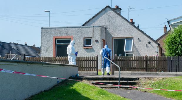 Forensic officers at the scene of the Grange Park blaze
