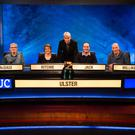 The Ulster University team, which appeared on University Challenge, with show quiz master Jeremy Paxman