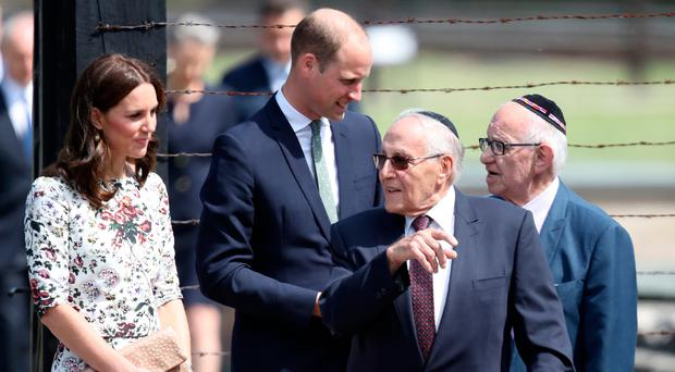 Prince William, Duke of Cambridge, and Catherine, Duchess of Cambridge talk with former prisoners of the Stutthof concentration camp