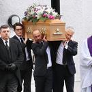 Julie Jones' coffin is carried out of the church