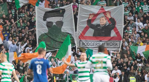 The two banners that a section of the Celtic support displayed against Linfield on Wednesday night