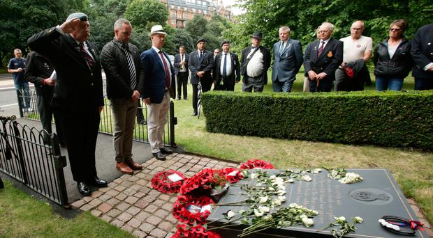 Mark Tipper (centre), whose brother Simon died, joins relatives of those killed in the IRA Hyde Park attack 35 years ago in laying a wreath