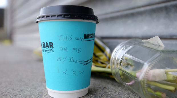 Business dream: David's coffee cup tribute left at Dean's barber shop in Carnmoney