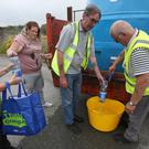 Residents at Termon Abbey in Drogheda queue for water supplied by Drogheda Council following a burst pipe