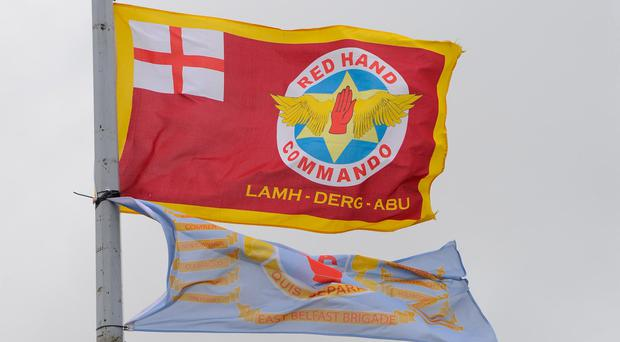 UDA and Red Hand Commando flags fly on lamposts