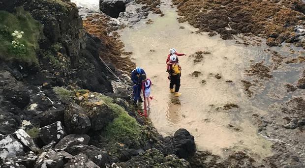The dramatic rescue near Castlerock, Co Londonderry, when a teenage girl was hoisted 100 feet up a cliff to safety, after becoming stranded by tides
