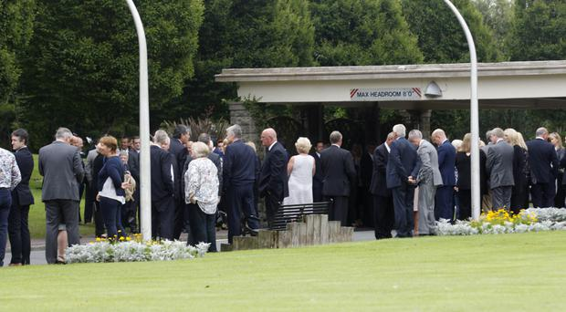 Mourners pay their final respects at the funeral of former estate agent Philip Johnston yesterday