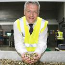 Andrew Jones during a visit to the G4S Cash Solutions Facility in Newtownabbey near Belfast